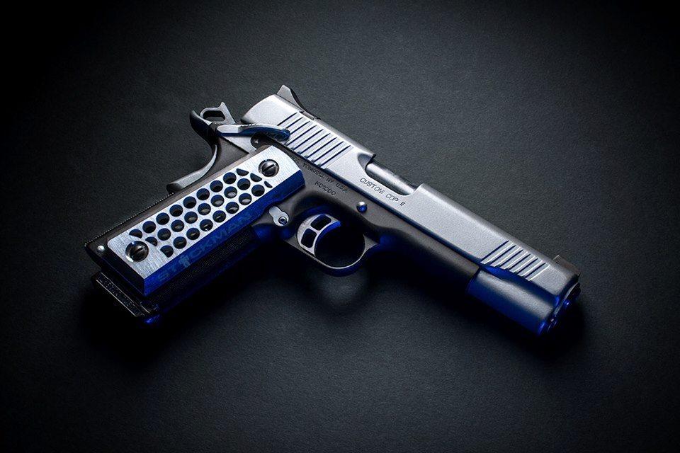 Gun in black background