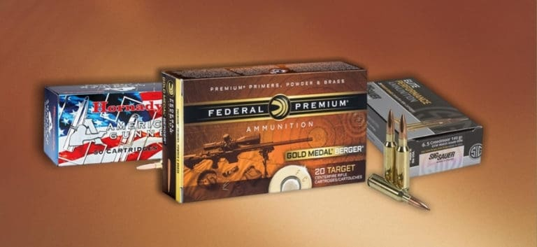 Three 6.5 Creedmoor Ammo in brown background
